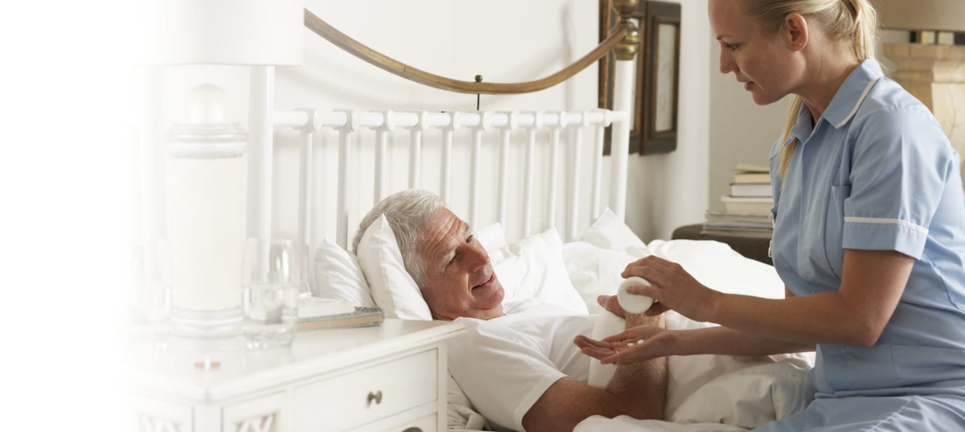 nurse with senior man patient on the bed